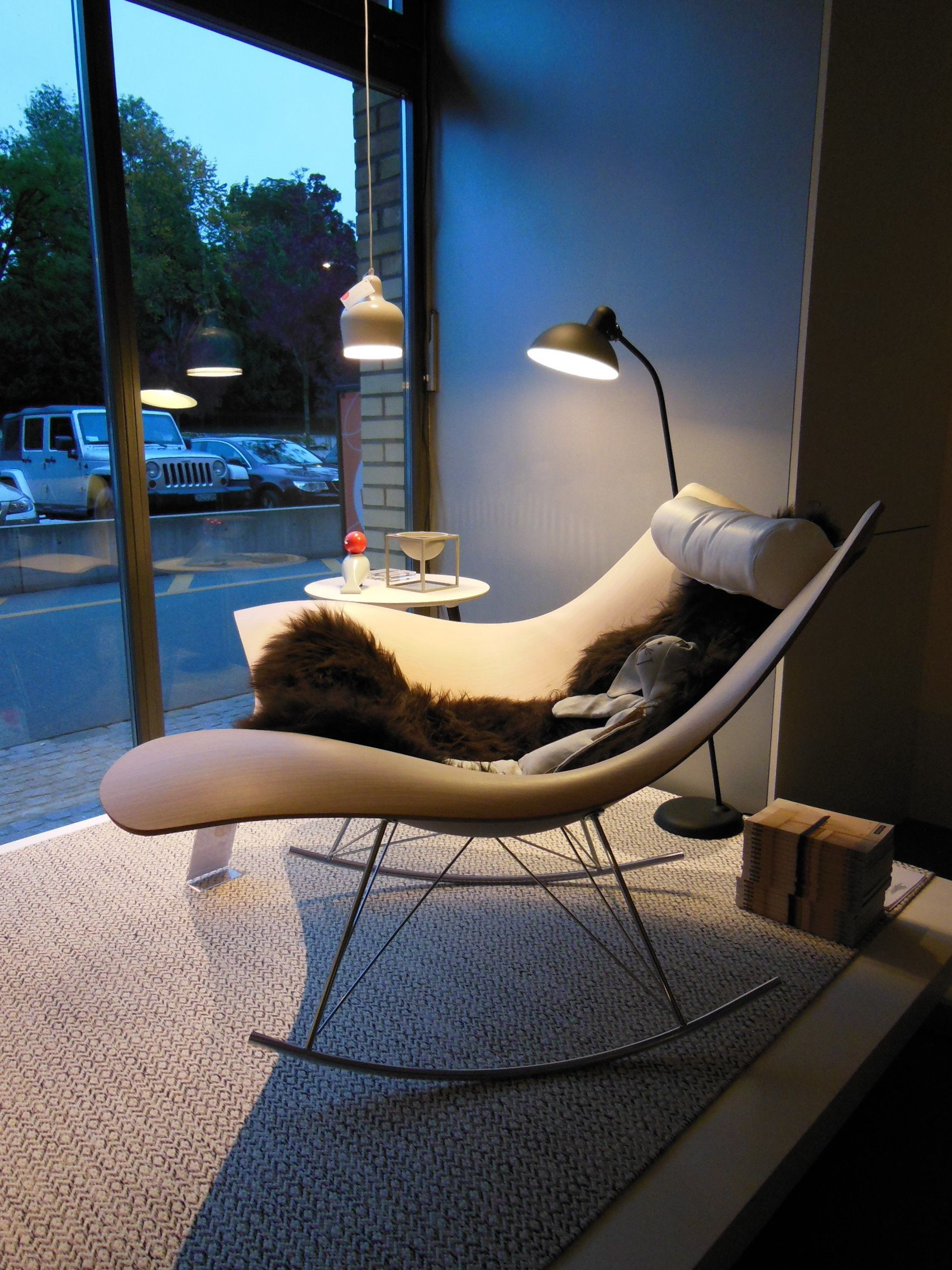 Stingray rocking chair by Thomas Pedersen from Fredericia Furniture, Kaiser idell floor lamp by Christian Dell from Fritz Hansen and Ingrid rug by Gunilla Lagerhem Ullberg from Kasthall