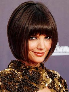 Katie's short China Doll cut is very on trend.