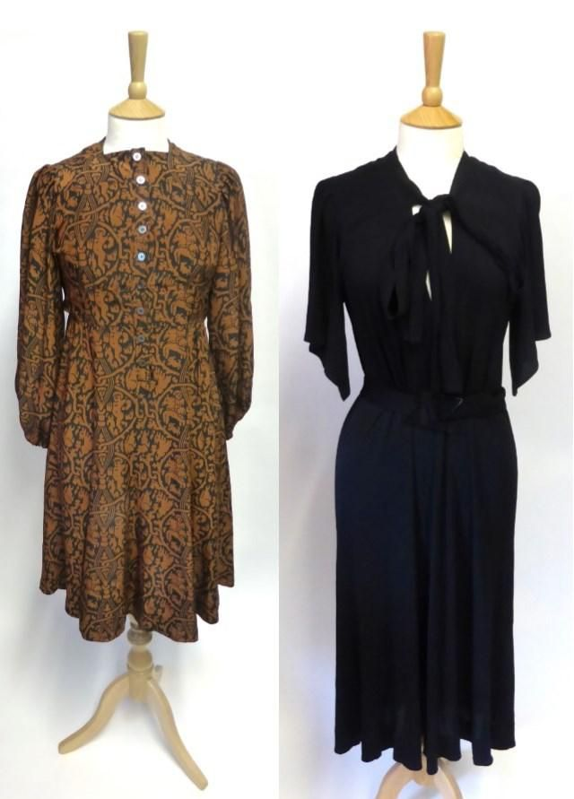 """Jean Muir. (1) """"Blue Jersey Dress with short sleeves, v-shaped neckline and neck ties, fabric belt. (2) Brown and Black Silk Dress with classical figures printed fabric, long gathered sleeves, round neck, buttons to the front.""""  Item Lot Number: 2095. Sold for GBP 110 in May 2015. Tennants Auctioneers: Jean Muir"""