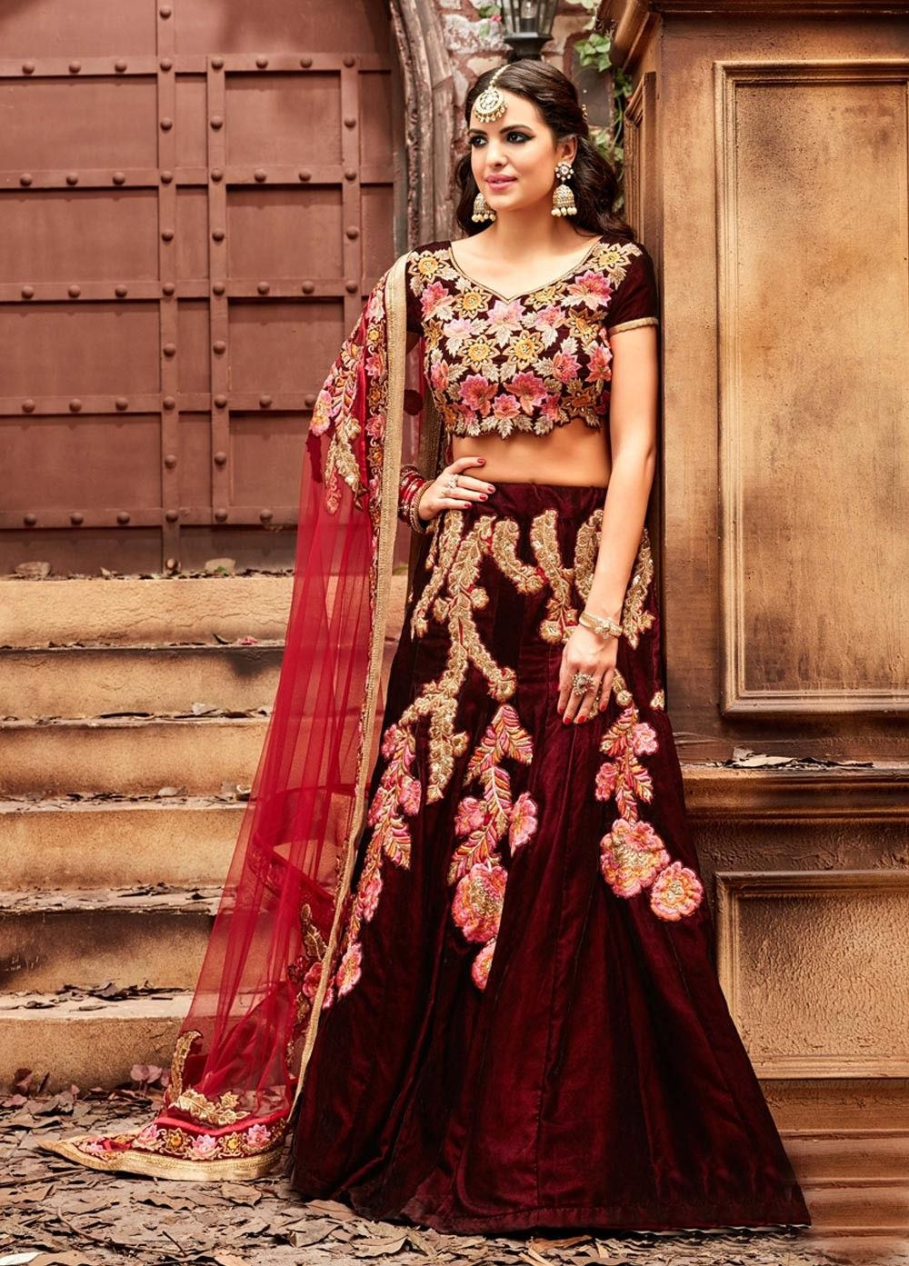 ade1614ffeb9 Shop Maroon color velvet wedding lehenga choli at kollybollyethnics online  from India and get free shipping offer