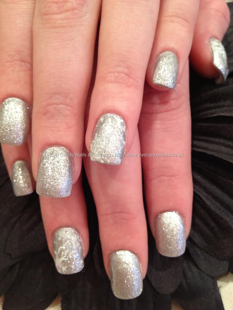 Silver glitter with white snowflake freehand nail art