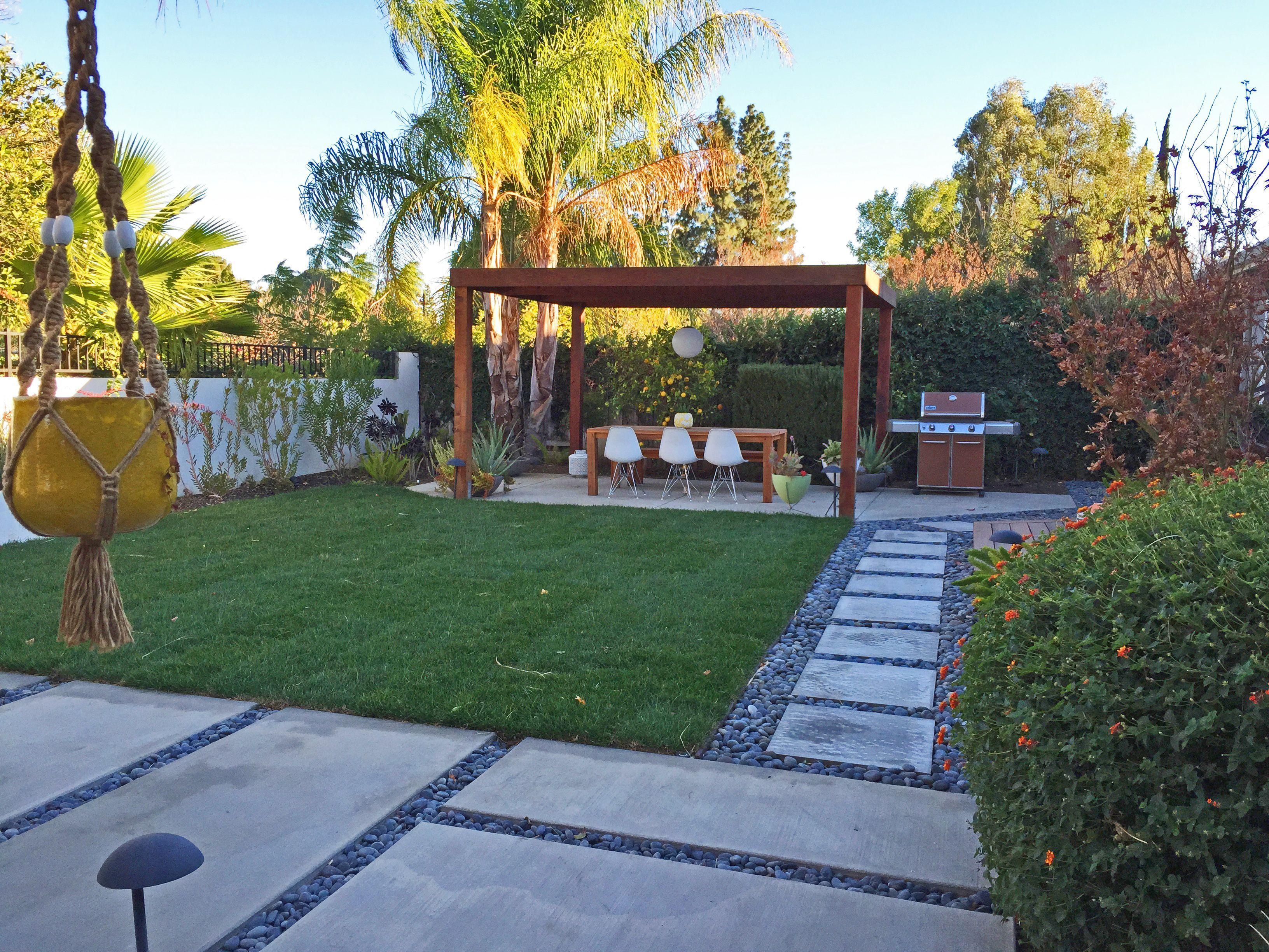 Midcentury modern backyard outdoor concrete pavers pads pergola