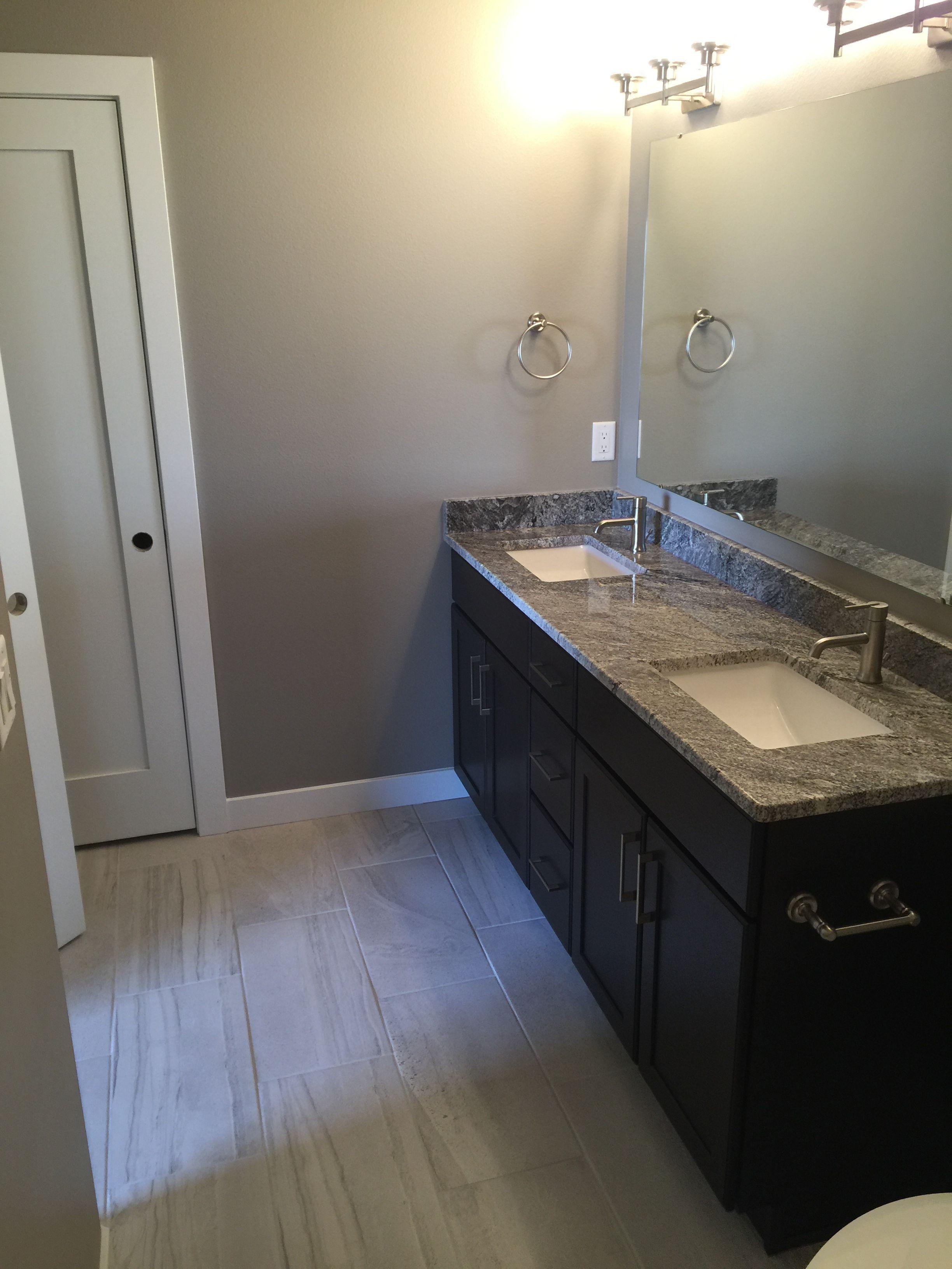 Flooring In 12x24 Porcelain Tile Installed At A 1 3 Staggered Tile Installation Bathroom Mirror Framed Bathroom Mirror
