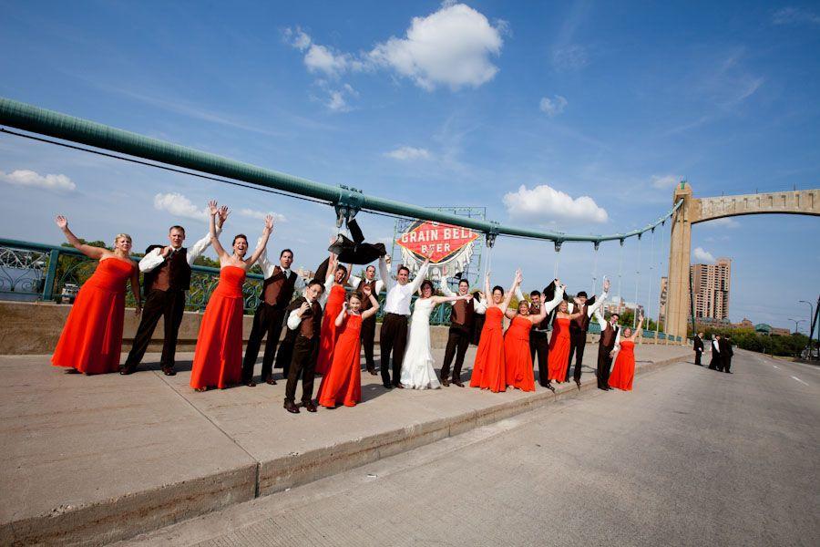 Wedding party showing Grain Belt some love on the Hennepin bridge! | Brovado Weddings