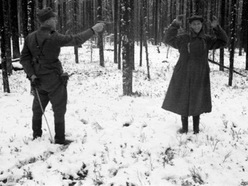 A Russian spy laughing through his execution in Finland, Rukajärvi, in East Karelia, in November 1942.