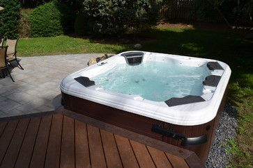 hot tub bullfrog spas with trex deck and cambridge paver patio