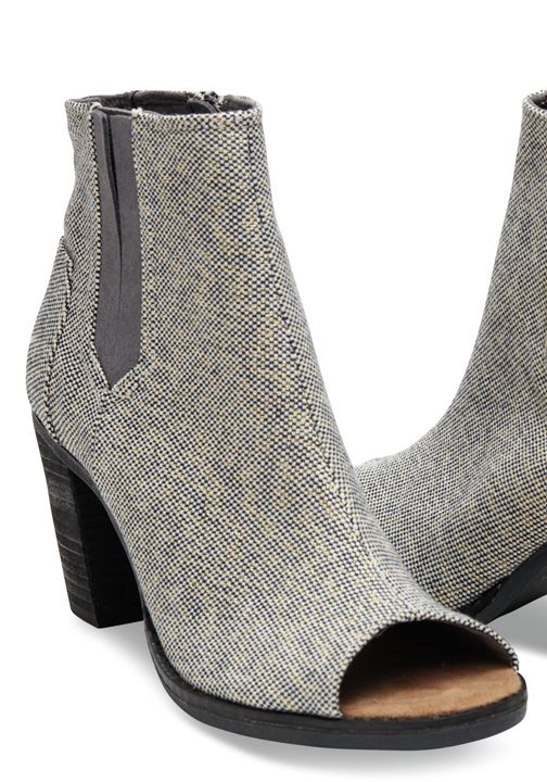 d6eed13632e3 Fashioned in metallic linen, these peep-toe booties add a touch of flair to  your more stylish outfits.