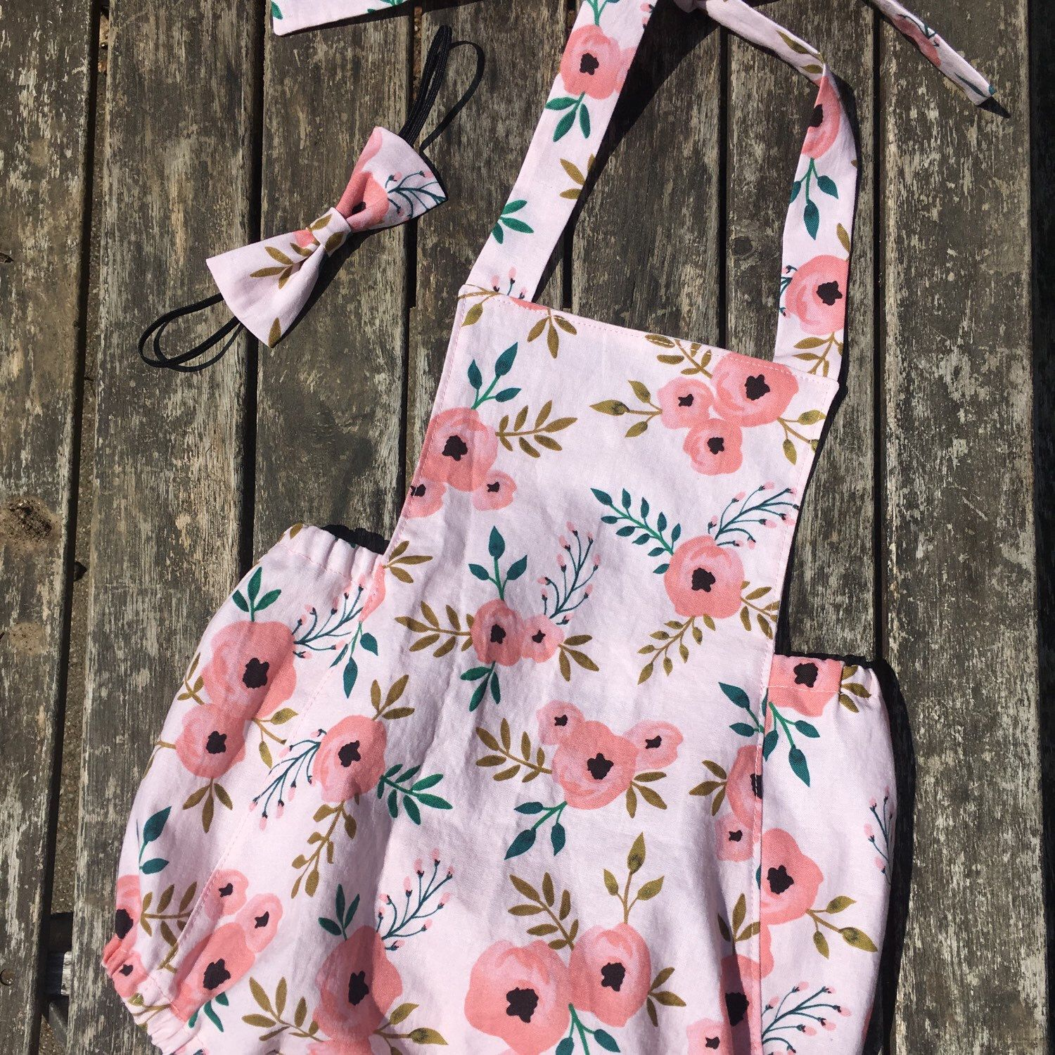 e2710cac5597a Beautiful new floral baby romper available now! Perfect for a spring or  summer wedding or romp in the garden 🌸