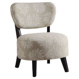 "Wood-framed accent chair with floral-print upholstery.    Product: Chair    Construction Material: Wood and fabric    Color: Beige    Features: Light floral print            Dimensions: 35"" H x 27"" W x 26"" D"