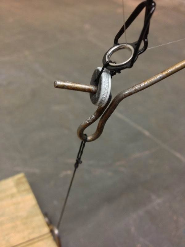 My new homemade rodholders with automatic hooksetting for Homemade ice fishing tip ups