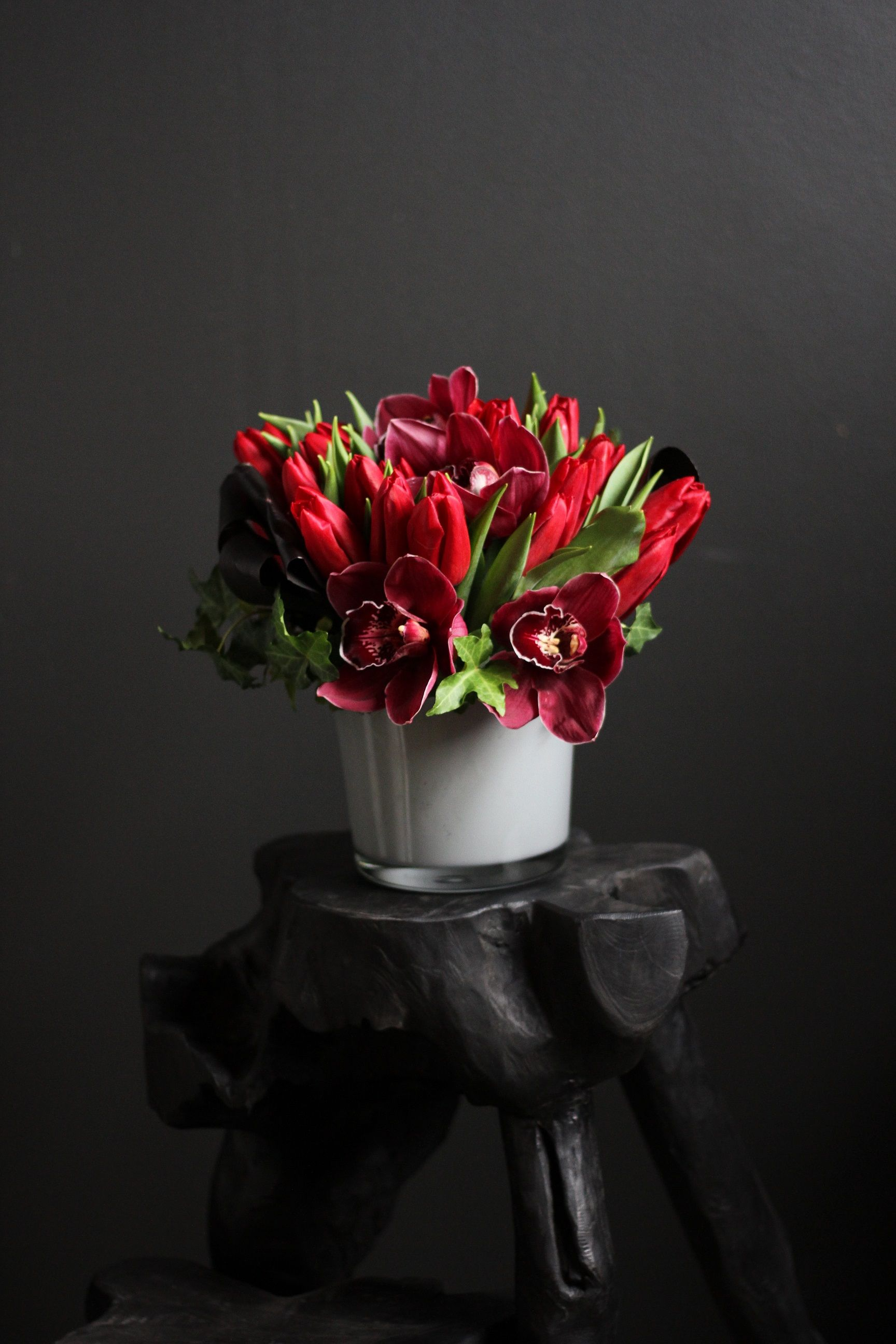 Red Tulips Designed With English Ivy And Cymbidium Orchids Tulip Kiss By Winston Flowers Valentine Flower Arrangements Valentines Flowers Winston Flowers