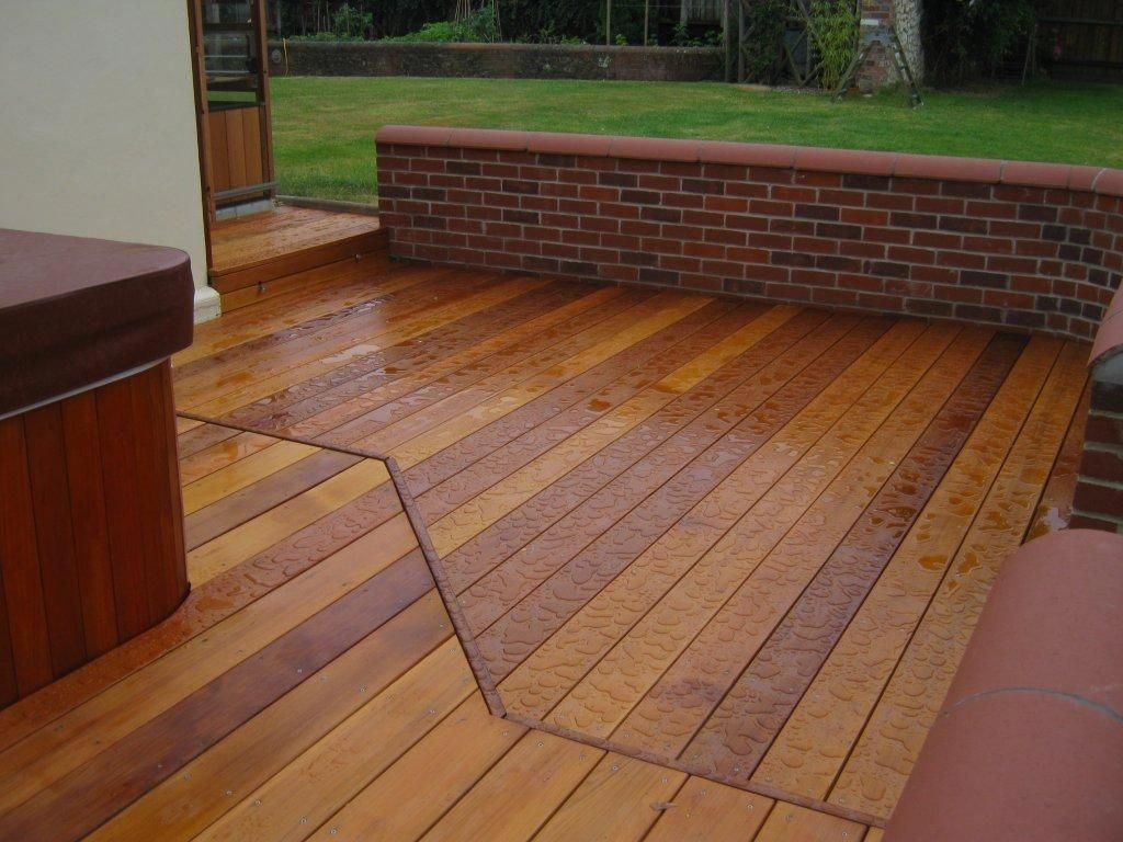 Cedar Decking Boards Often Used Pressure Treated Lumber When It Comes To Decking But There Are Several Other Inter Deck Boards Cedar Deck Deck Building Cost