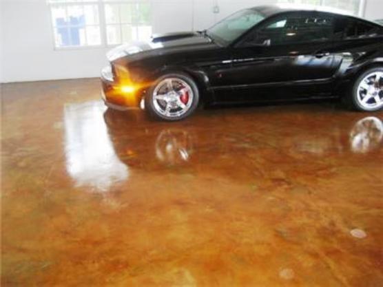 Acid stained concrete garage floor pinterest for How to clean stained concrete garage floors