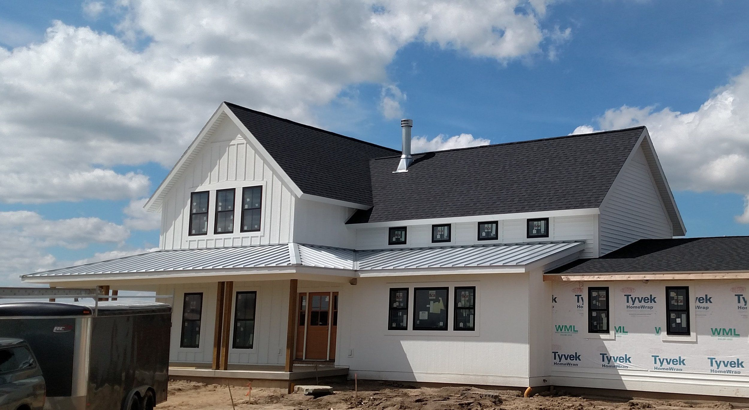 Mixed Roofing Roofing White Siding Metal Roof