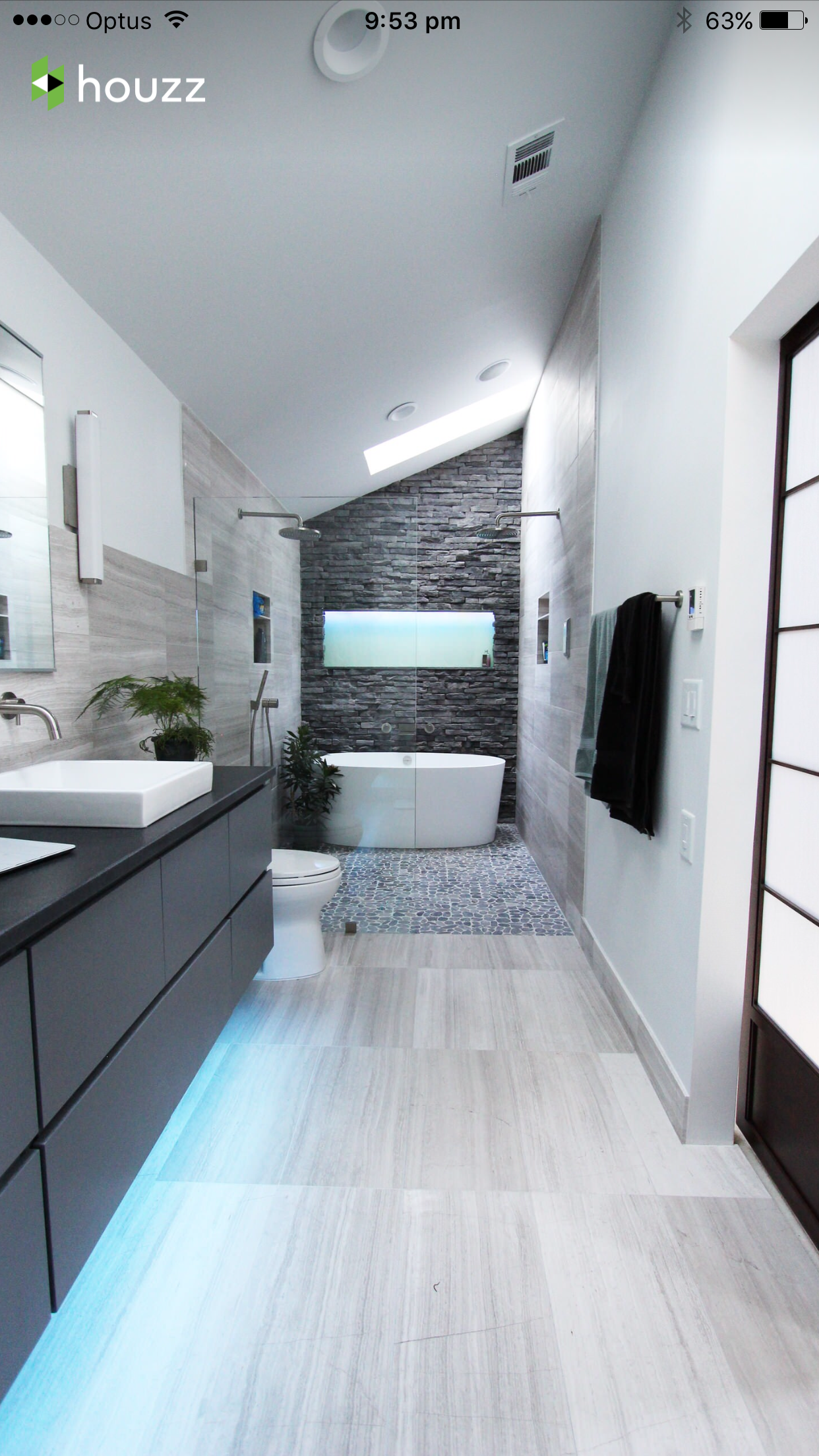 Long narrow bathroom, double shower and vanity glass wall to create ...