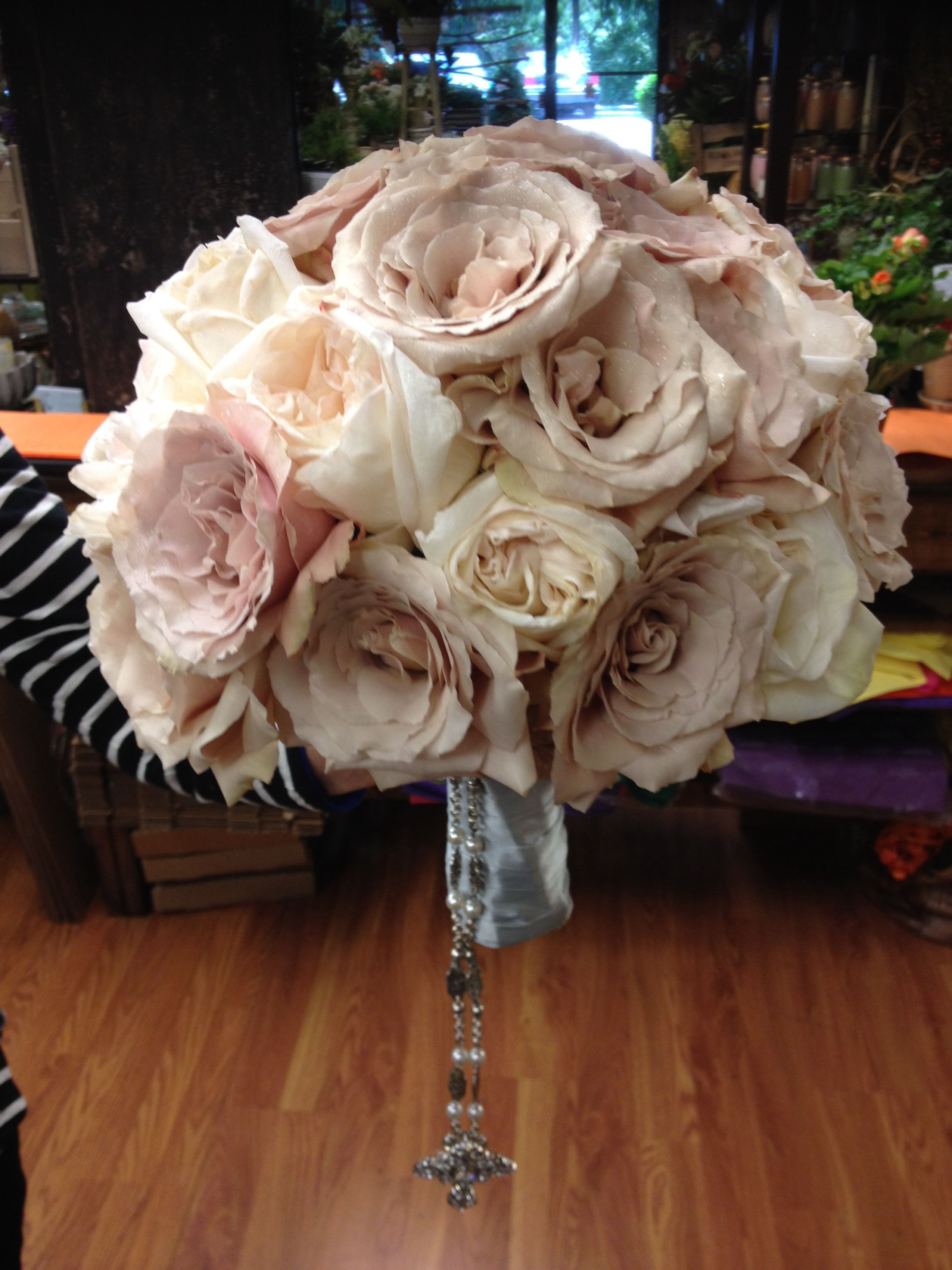 Hand tied cluster of open quicksand roses and white Ohara garden ...
