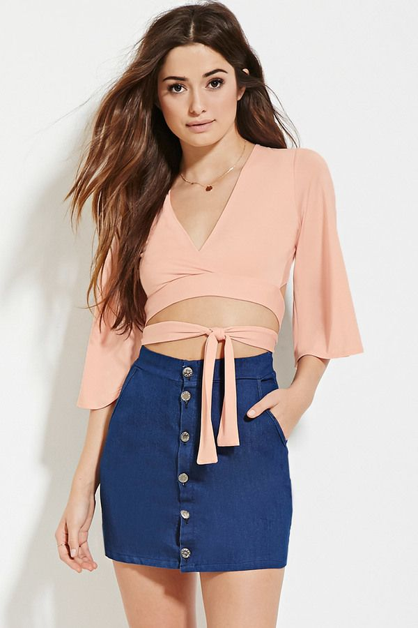 afe38f11f8 This cool wrap crop top looks perfect with a button front skirt ...