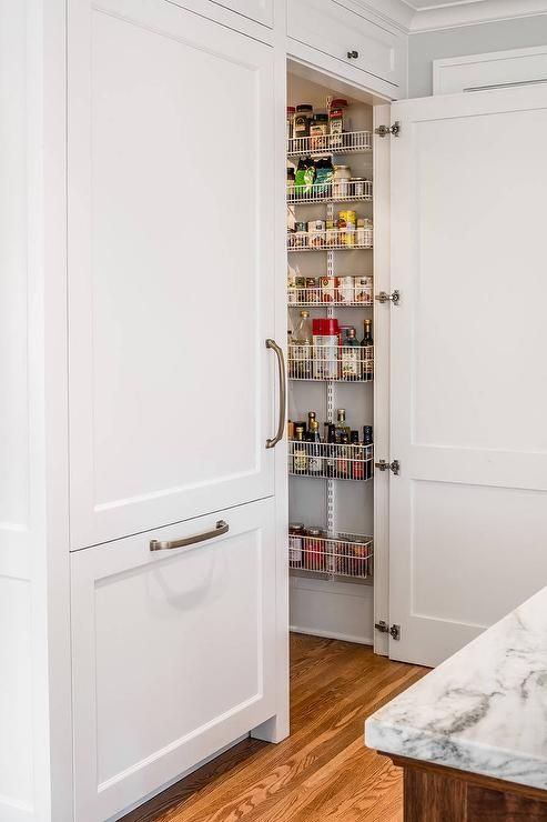 Beside An Inset White Paneled Refrigerator A White