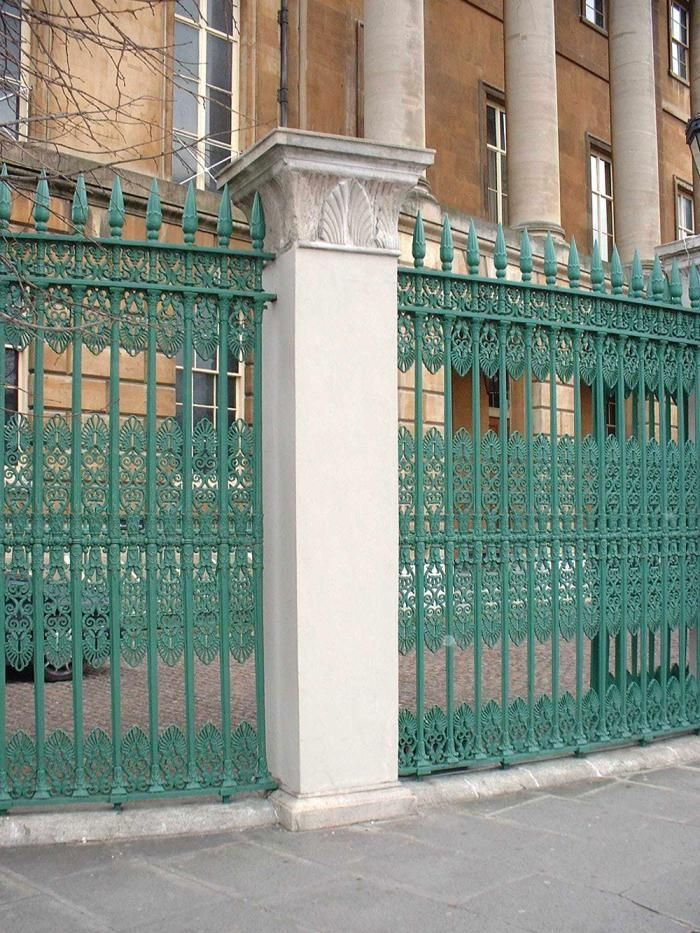 Paint Colors For Iron Gates And Fences Gardenista Wrought Iron Railing Exterior Iron Gates Iron Balcony