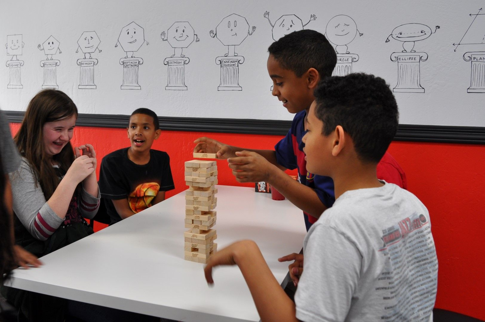 Sophia, Jaylen, Obai and David playing an exciting game of Jenga.
