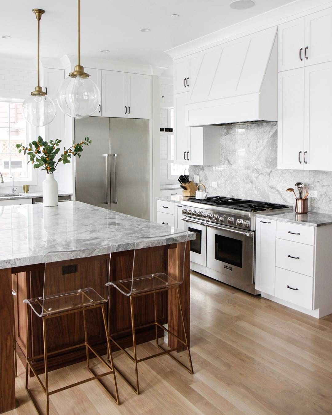 white marble kitchen with gold and wood | kitchen
