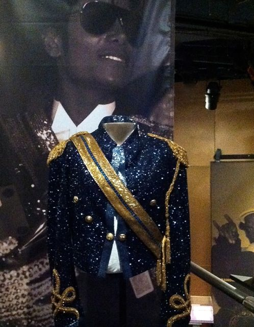 9d3c7f4fc0 Michael Jackson s sequined military-style jacket and sash that he wore to  the 1984 Grammys (designed by Michael Bush) on exhibit at the Rock and Roll  Hall ...