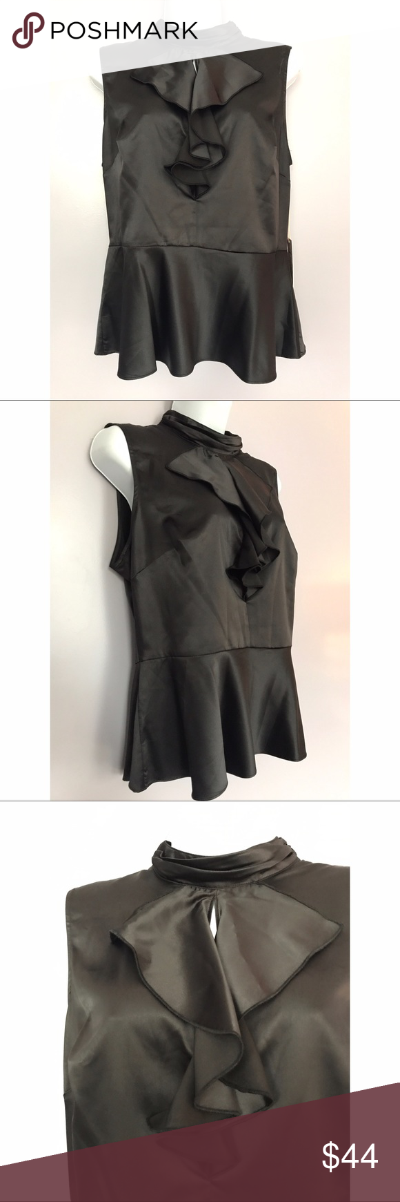 {Nanette Nanette Lepore} Silk-Like Peplum Top Sleek peplum top from Nanette Nanette Lepore. Ruffle detail, layered neck.        Location: B3 Nanette Lepore Tops