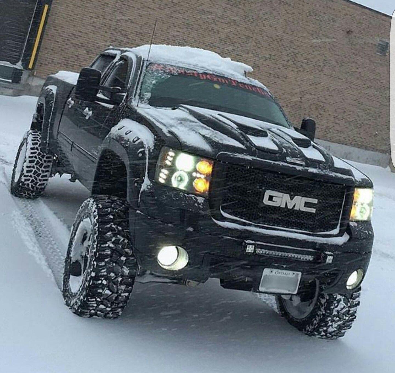Lifted black gmc Denali duramax sel in snow