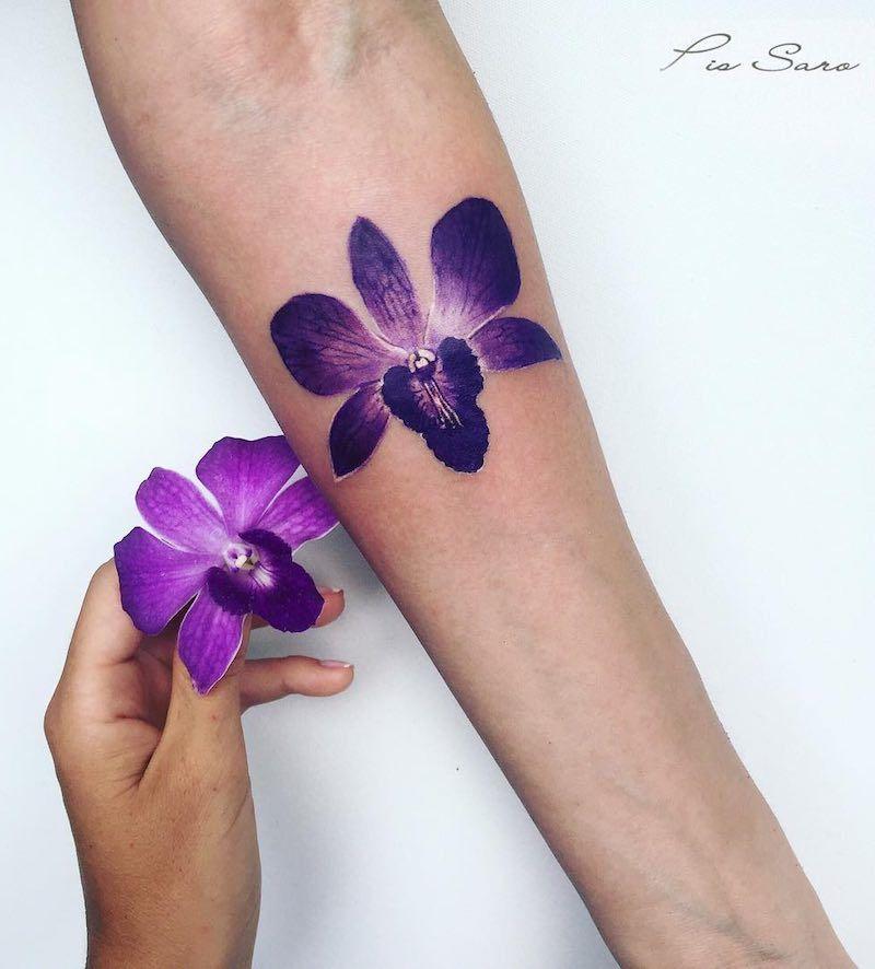 117 Of The Very Best Flower Tattoos Tattoo Insider Purple Orchid Tattoo Purple Tattoos Orchid Flower Tattoos