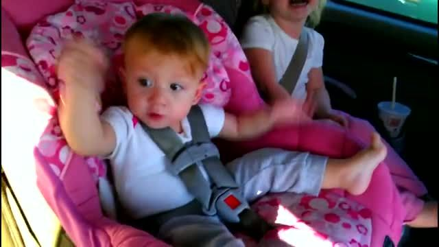 This toddler is sound asleep in the car, then her favorite song comes on the radio.  Watch her come alive . . .