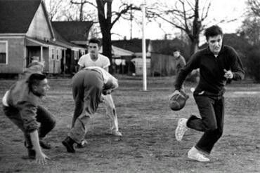 Elvis Presley playing Football with the guy's