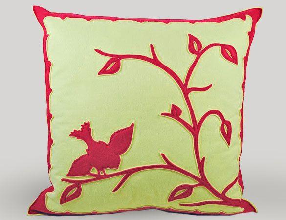 Beautiful bird and branch applique pillow.