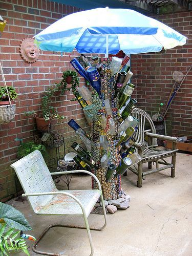 DIY Upcycle Recycle Bottles (This is made with beer bottles could adapt for wine bottles) - Garden Art - Trellis? Description from pinterest.com. I searched for this on bing.com/images