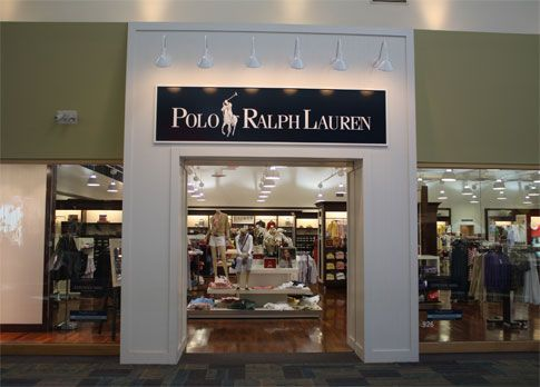 cc6f5d335c6 Polo store front utilizes iconic brand logo against the stark contrast of  the white wall to grab customers  attention. Polo Ralph Lauren Factory ...