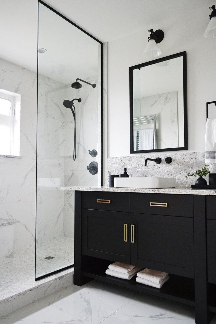 Jaclyn Peters Design Black and white bathroom Cambria Quartz Summerhill  Brass hardware Black faucet Schoolhouse Electric