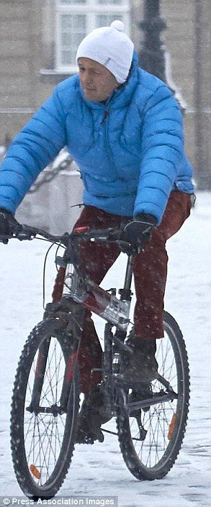 Frederik wore a bright blue jacket and red jeans for the short bike ride...