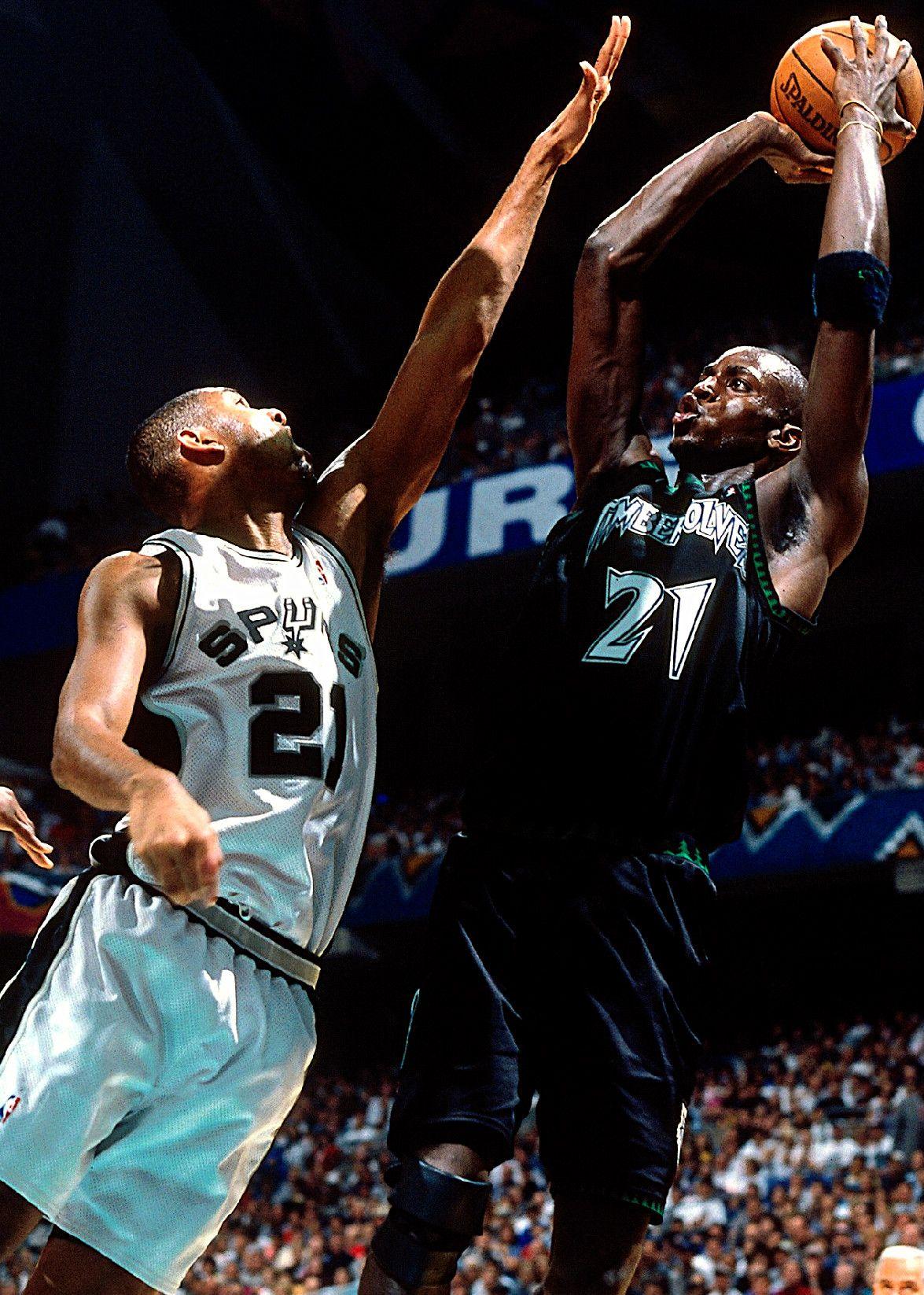 Kevin Garnett shoots over Tim Duncan www.kingsofsports.com