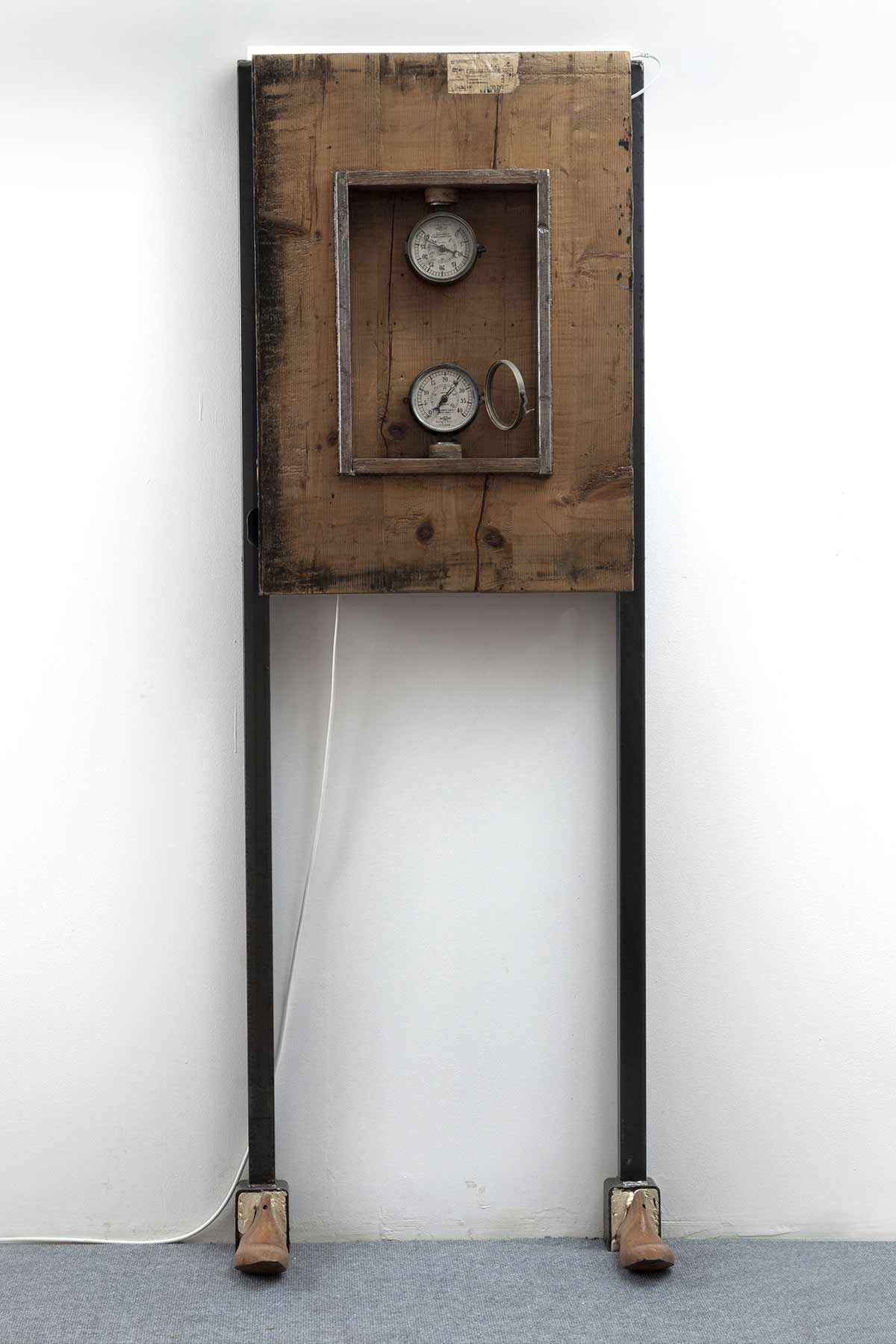 COMBINATION – TIMELESS / PART 3 1930 – 2015 / ATR 1972  Size: iron – wood- glass – brass Mixed media: 64 x 180 x 14 cm Maurizio Di Feo