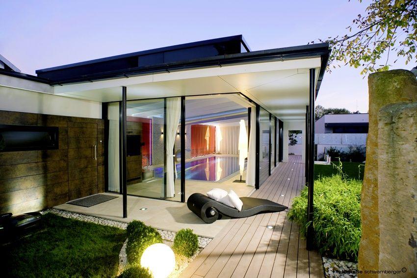 Glasshouse als overdekking zwembad design veranda moderne