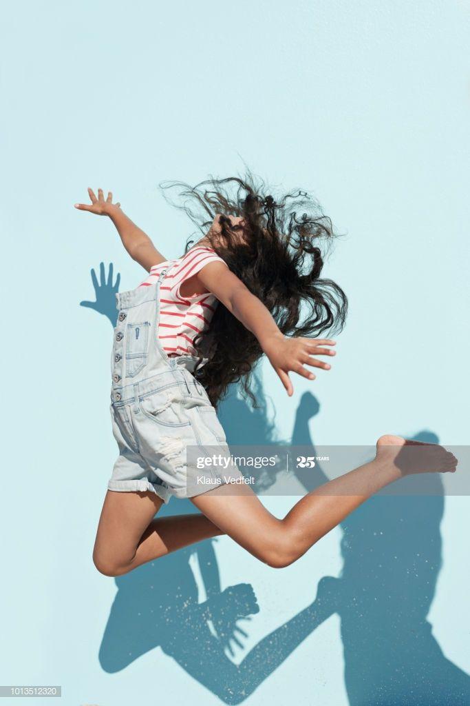 Studio Shot Of Girl Jumping In Sunlight On Studio Backdrop Photography #Ad, , #affiliate, #Girl, #Shot, #Studio, #Jumping