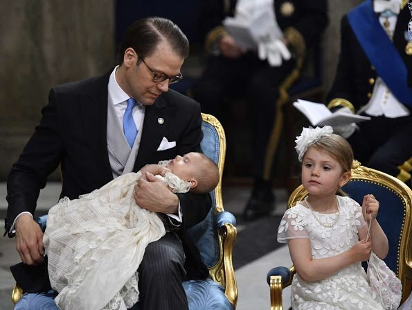 Prince Oscar w/dad Prince Daniel w/Princess Estelle at Oscar's christening May 2016