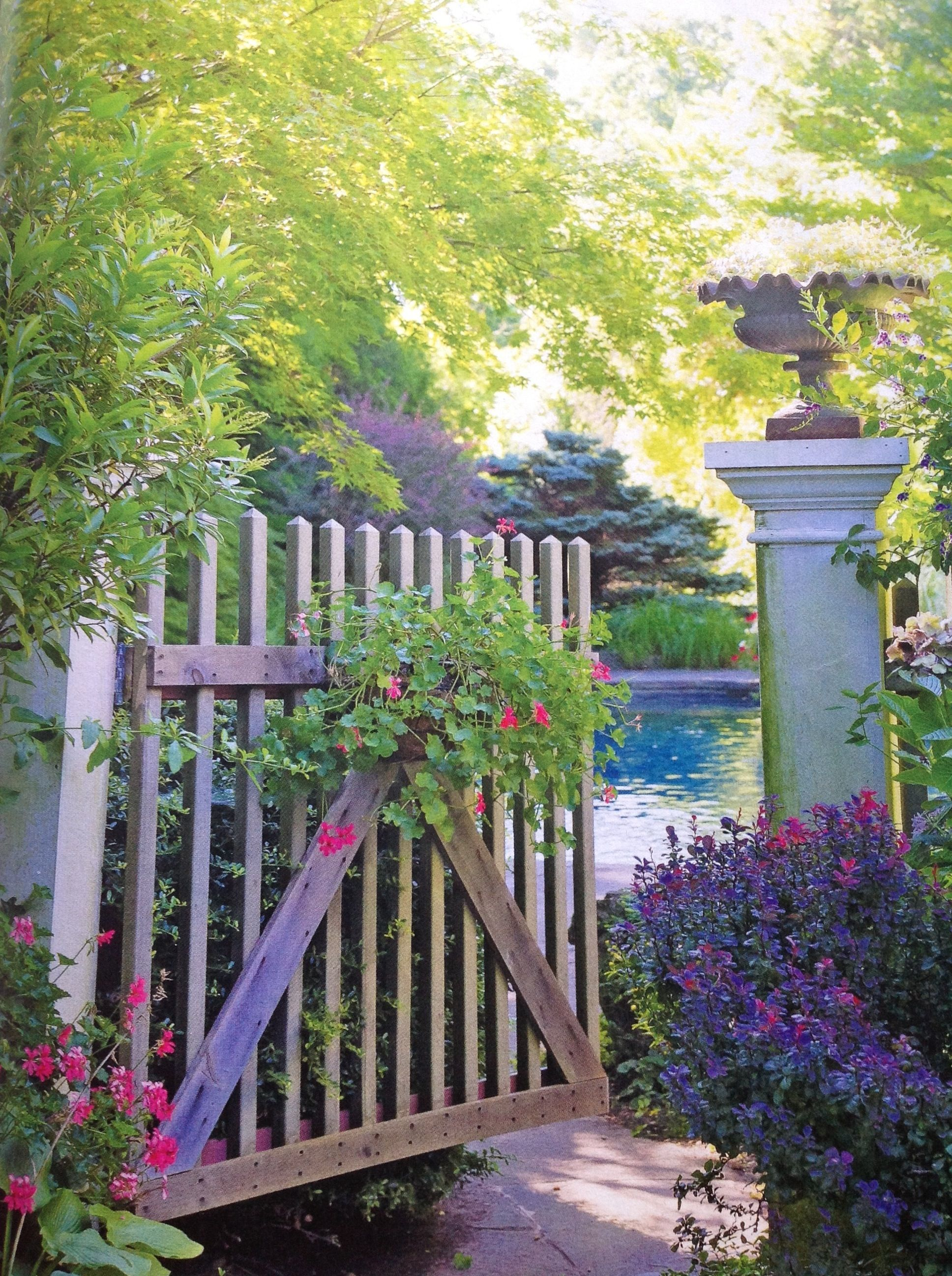 Like wooden slat gate with draping hanging basket (from bhg Deck, Patio, & Outdoor Living magazine)