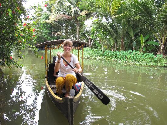 Rowing the boat in small canals in alleppey backwaters
