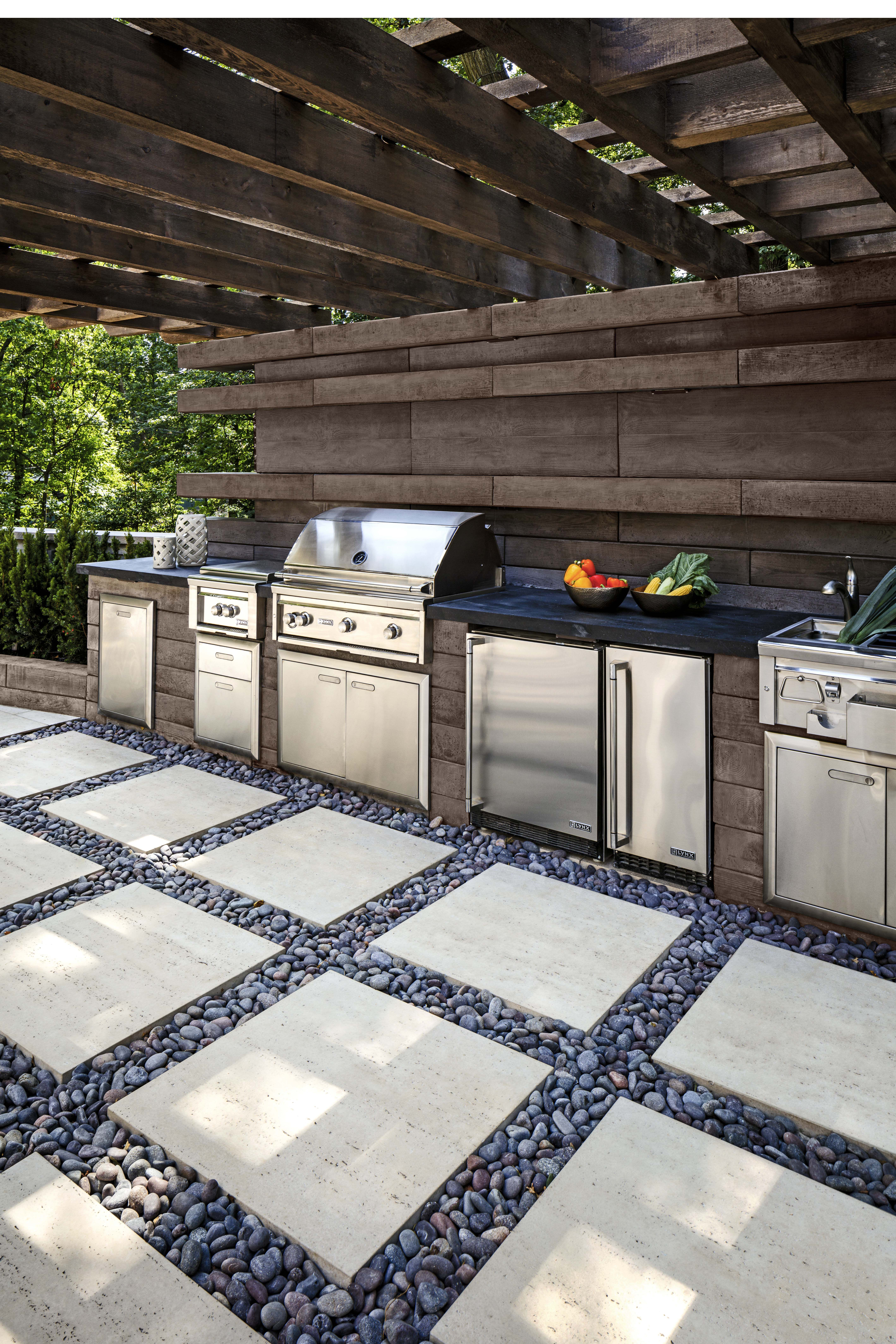 Looking for a an outdoor kitchen idea? For this landscape