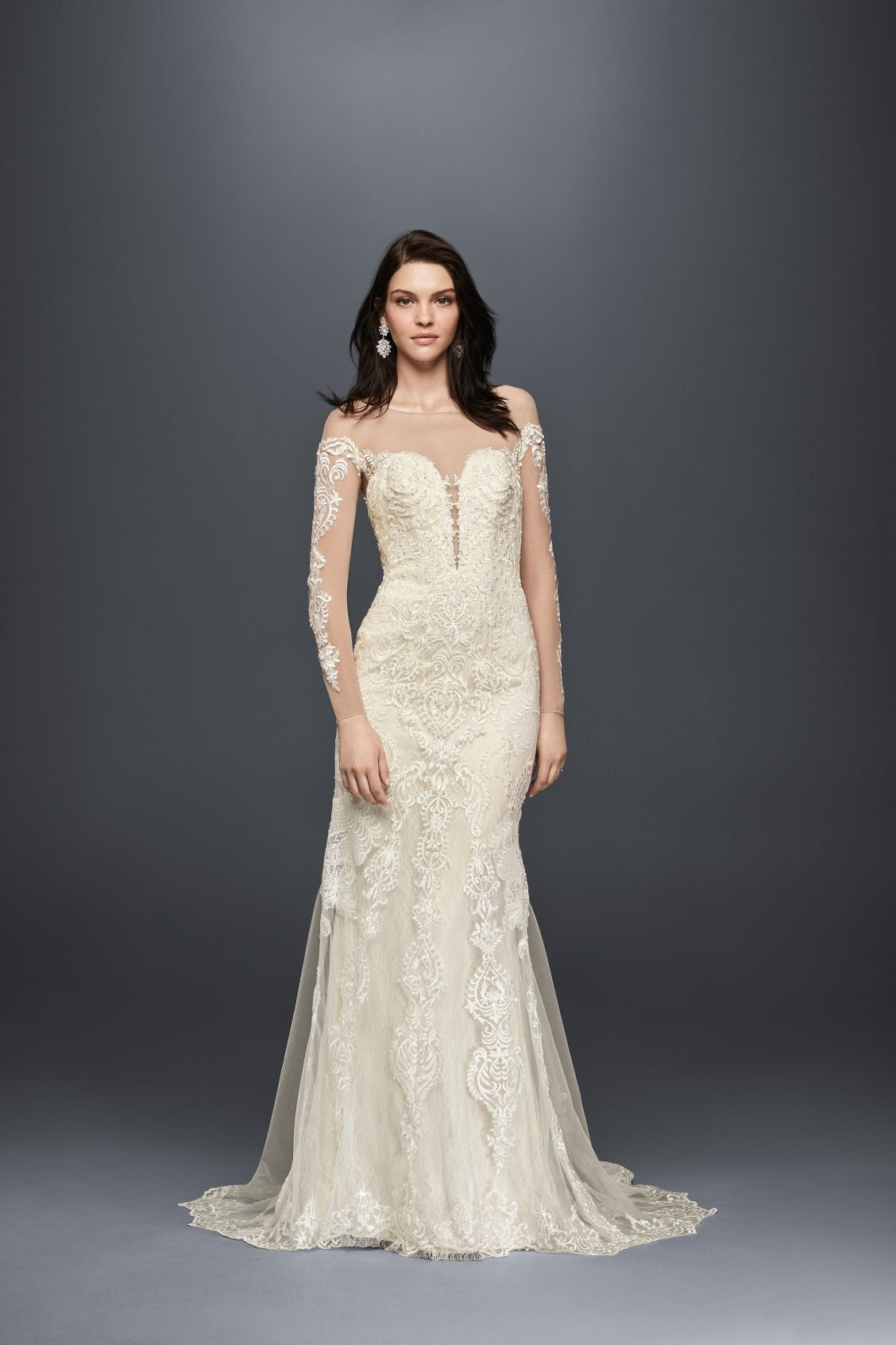 A slinky sheath wedding dress with illusion neckline and lace