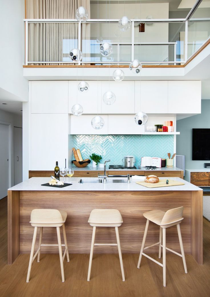 Interior Design By Falken Reynolds Vancouver Loft Kitchen And Deck With American Mid Century Modern Inspired Walnut Cabinets Caesarstone Counter