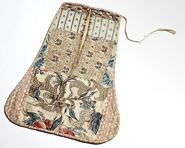 18th century Block Printed Pocket Block printed linen pocket, signed HVV, with a wonderful assortment of brown, pink/red, and blue clothing and furnishing prints. VG condition, missing one tie. New England, 4th Quarter 18th c.