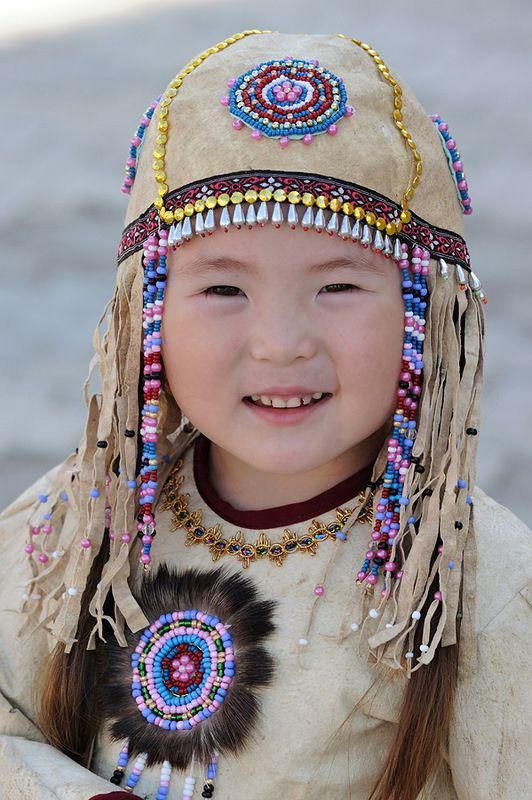 A little Yakutian girl in traditional dress.  Republic of Sakha (Yakutia) in the Russian Federation.