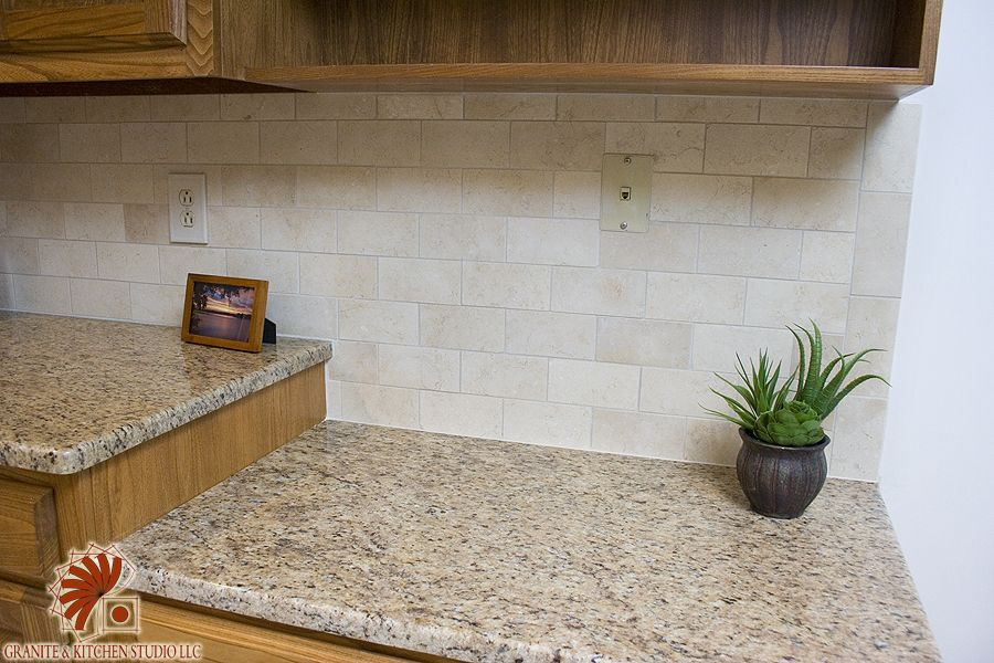 Crema Marfil tile with Giallo Ornamental granite counter top - installed in  Simsbury CT