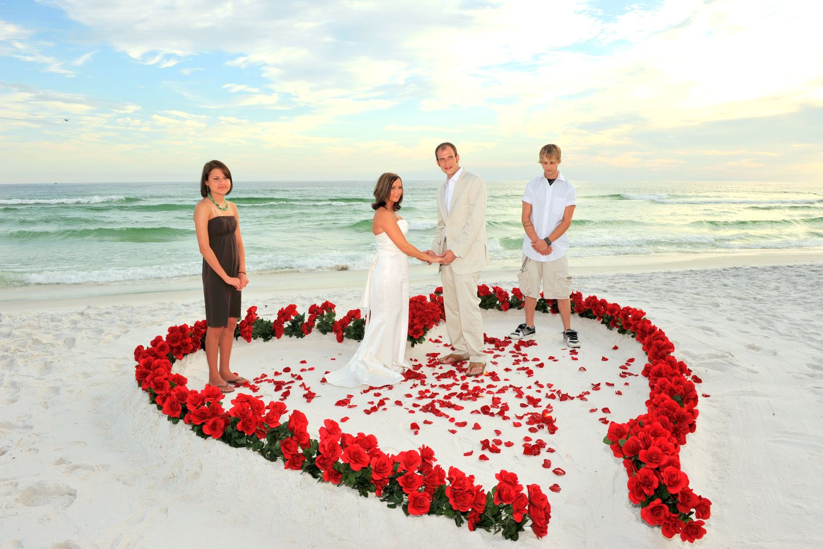 Heart Shaped White Beach Wedding Idea With Red Flowers